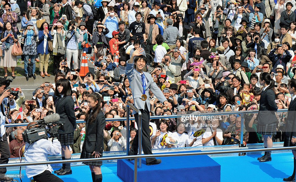 Sochi Olympics figure skating Men's Singles gold medalist Yuzuru Hanyu waves during his gold medal parade on April 26, 2014 in Sendai, Miyagi, Japan. 92,000 people celebrate the gold medalist.