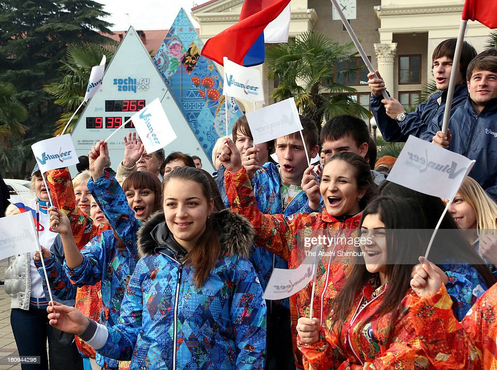 Sochi people and volunteers celebrate the 'One Year To Go Before Sochi Winter Olympic' in front of the count down clock on February 7, 2013 in Sochi, Russia. Sochi Winter Olympics begins on February 7, 2014.