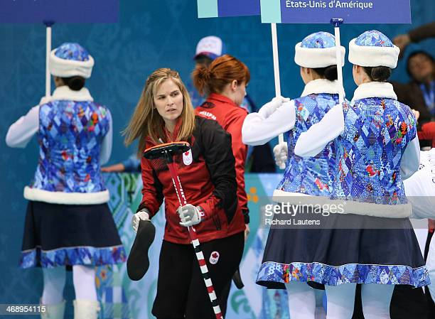 Sochi Russia February 12 SSOLY Canadian skip Jennifer Jones tries to make her way to the sheet around the women carrying the team names At the Winter...