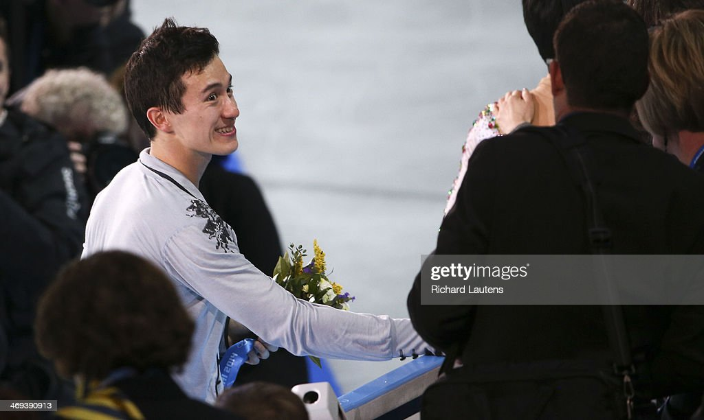 Sochi, Russia - February 14 - SSOLY- Canadian Patrick Chan stumbled several times during his performance. He finished with a silver medal. Chan smiles for the crowd following the flower ceremony. At the Winter Olympics in Sochi, the men's free skate was held at the Ice Berg. February 14, 2014