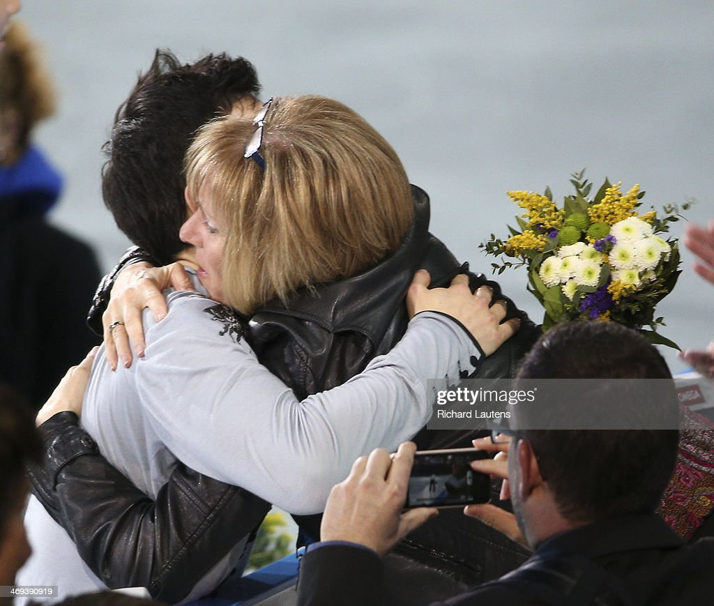 Sochi, Russia - February 14 - SSOLY- Canadian Patrick Chan stumbled several times during his performance. He finished with a silver medal. Chan gets a hug following the flower ceremony. At the Winter Olympics in Sochi, the men's free skate was held at the Ice Berg. February 14, 2014