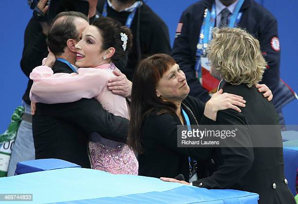Sochi Russia February 16 SSOLY American pair of Meryl Davis and Charlie White hug their coaches as they leave the ice At the Winter Olympics in Sochi...