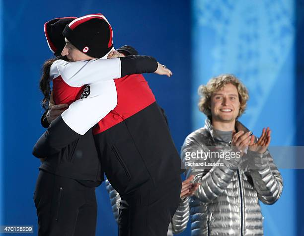 Sochi Russia February 18 SSOLY Tessa and Scott have a hug while rival and gold medalist Charlie White looks on At the Winter Olympics in Sochi the...