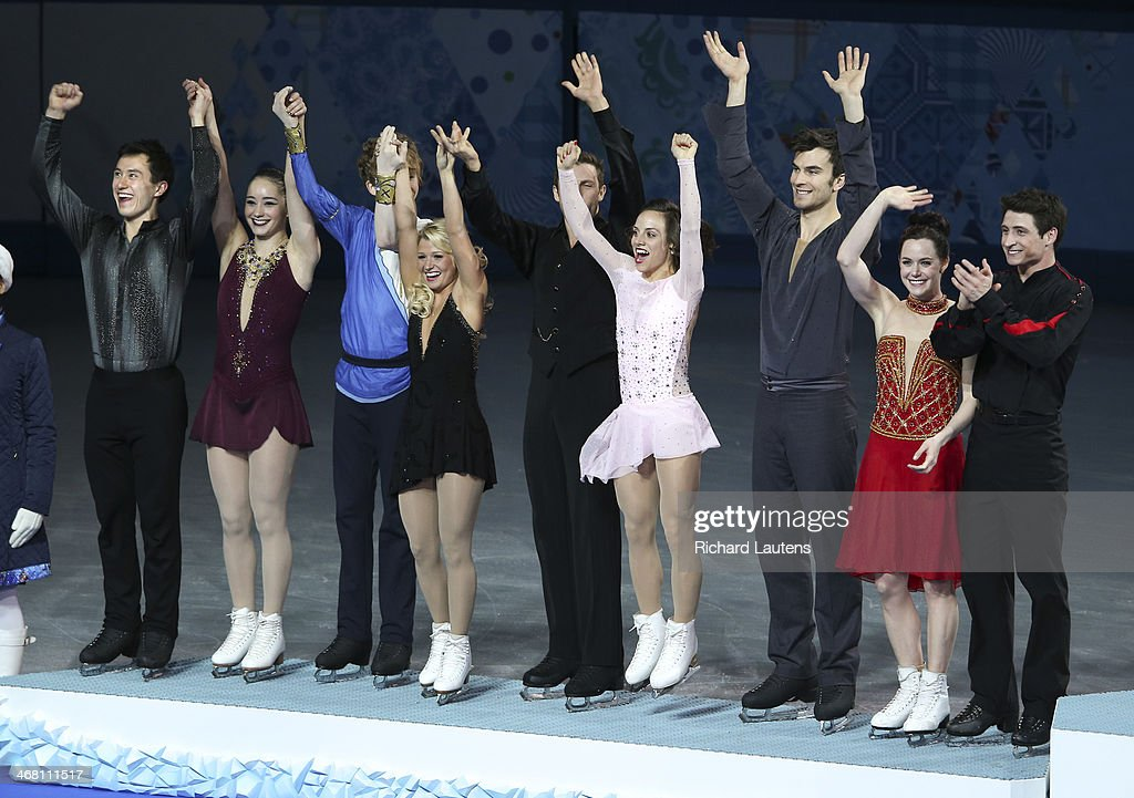 Sochi, Russia - February 9 - SSOLY-At the Winter Olympics in Sochi, the finals of the team figure skating competition was held at the Iceberg. Canada earns a silver medal with Russia winning the gold and USA the bronze. Left to right are: Patrick Chan, Kaetlyn Osmond, Kevin Reynolds, Kirsten Moore Towers, Dylan Moscovitch, Meagan Duhamel, Eric Radford, Tessa Virtue and Scott Moir. February 9, 2014