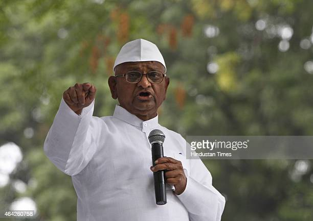 Social activist Anna Hazare addressing the crowd during start of his twoday agitation against the land acquisition ordinance at Jantar Mantar on...