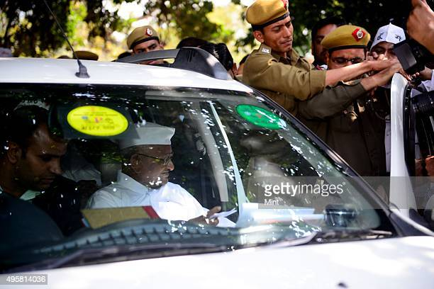 Social activist Anna Hazare arrives during a press conference at Constitution Club on March 14 2014 in New Delhi India