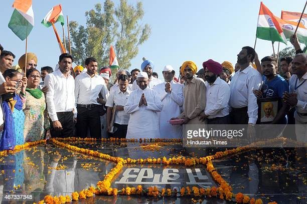 Social activist Anna Hazare paying tribute to ShaheedEAzam Bhagat Singh at memorial in his village Khatkar Kalan to mark martyrdom day on March 23...