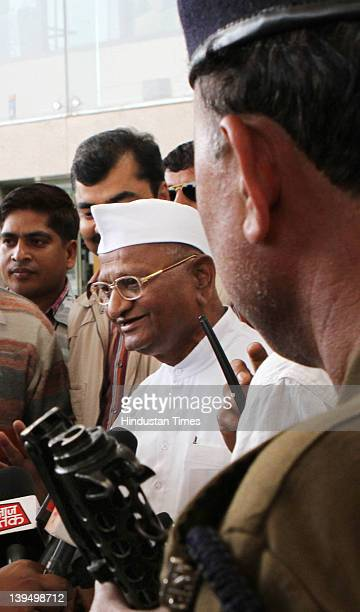 Social activist Anna Hazare talks to the media after arriving at the airport on February 22 2012 in New Delhi India Returning after getting a...