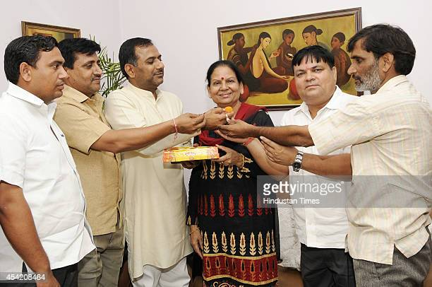 Social activist Vimla Batham celebrate after being nominated as BJP candidate from Noida assembly seat on August 26 2014 in Noida India The BJP...