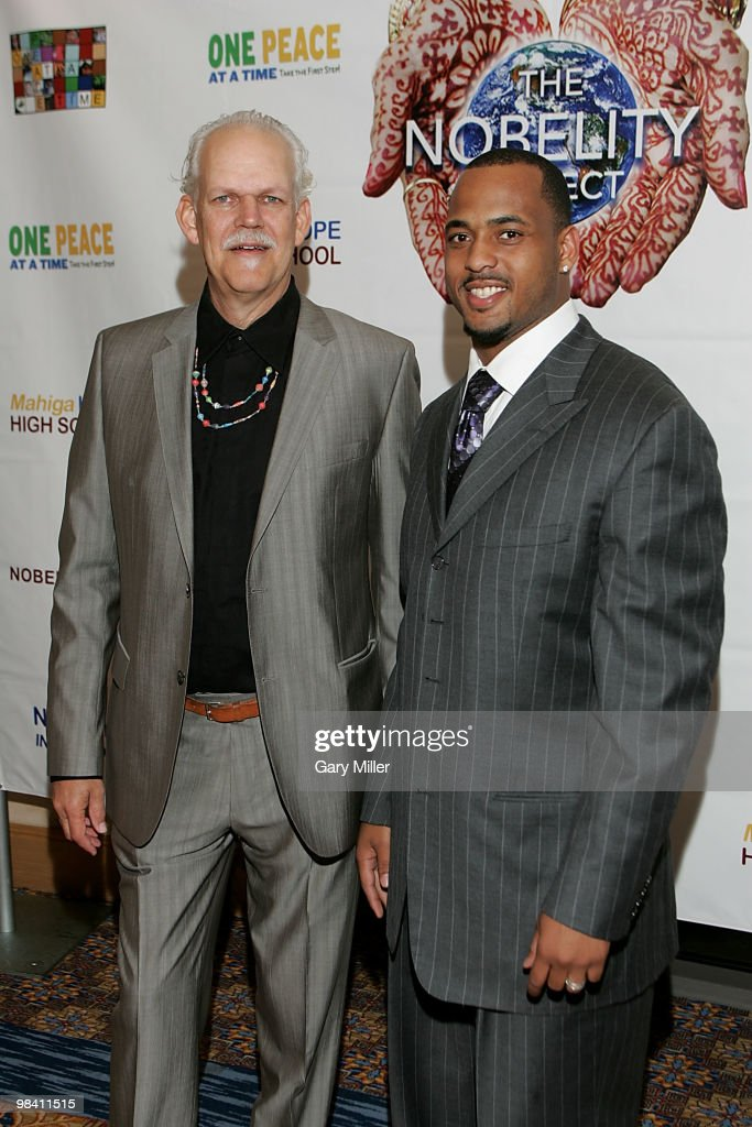 Social activist/author/filmmaker Turk Pipkin (L) and football player Derrick Johnson of the Kansas City Chiefs pose on the red carpet for the Nobelity Project's dinner honoring country music legend Willie Nelson with the 'Feed The Peace' award at the Four Seasons Hotel on April 11, 2010 in Austin, Texas.