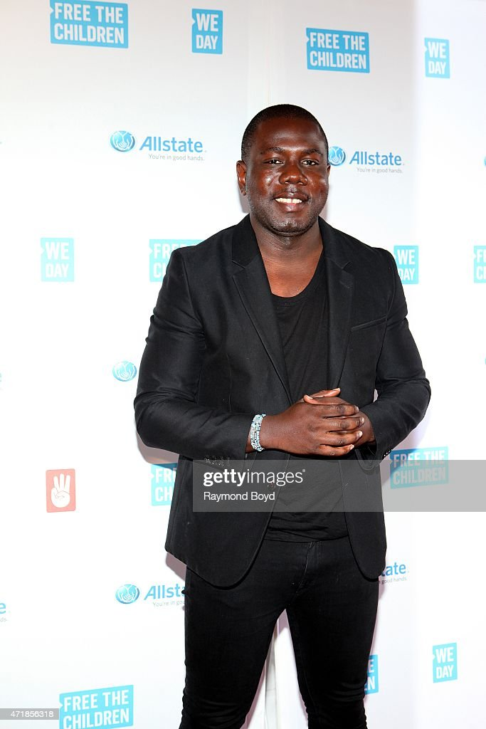 Social advocate, filmmaker and Grandson of the late, Nelson Mandela, Kweku Mandela poses for photos on the red carpet during 'We Day' at the Allstate Arena on April 30, 2015 in Rosemont, Illinois.
