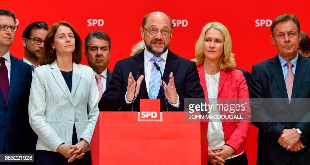 Social Democratic Party leader Martin Schulz addresses a press conference at the headquarters of the SPD in Berlin on May 15 one day after regional...