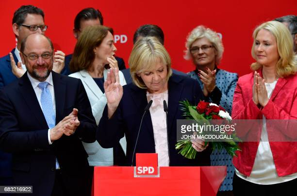 Social Democratic Party leader Martin Schulz applauds as Hannelore Kraft the SPD's lead candidate in regional elections in the West German state of...