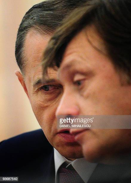 Social Democratic Party Presidential candidate Mircea Geoana speaks to National Liberal Party presidential candidate Crin Antonescu prior signing an...