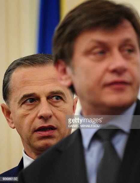 Social Democratic Party Presidential candidate Mircea Geoana walks next to National Liberal Party presidential candidate Crin Antonescu prior signing...