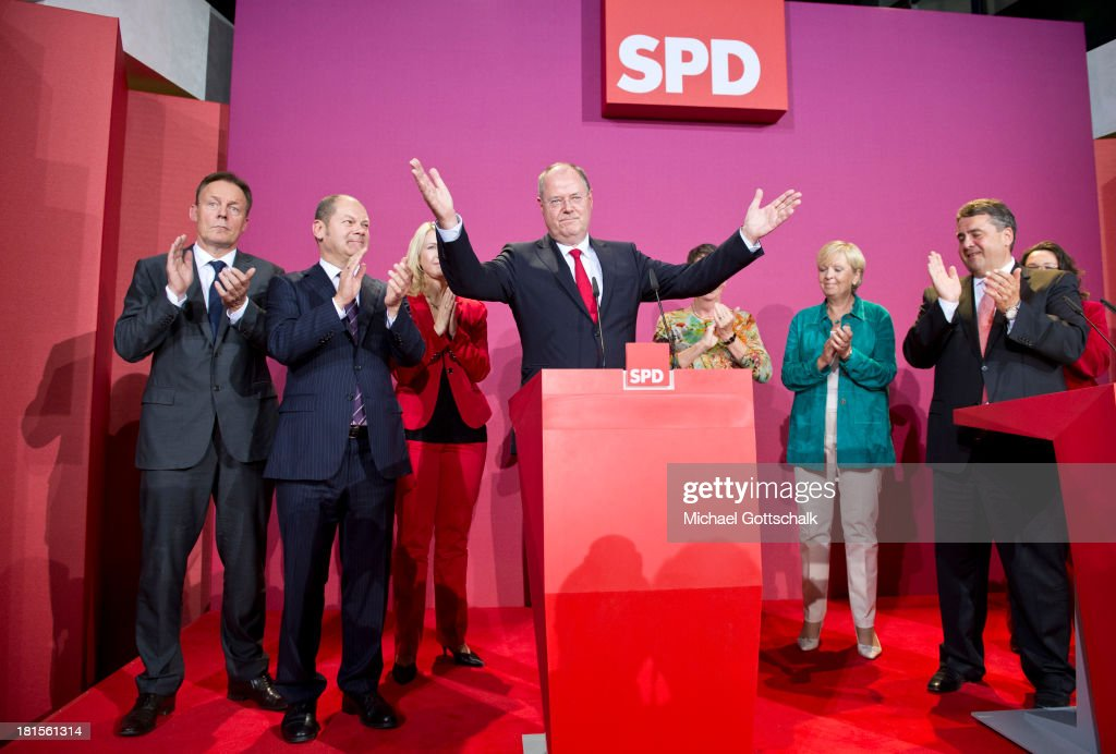 Social Democrats (SPD) chancellor candidate Peer Steinbrueck (C) and Sigmar Gabriel (R), SPD Federal Chairman, (L-R) Thomas Oppermann, chairman of the parliamentary control commission (Parlemantariches Kontrollgremium) of the Bundestag, Olaf Scholz, Hamburg's First Mayor, Manuela Schwesig, Labor Secretary in Mecklenburg-West Pommerania and deputy leader of the SPD, Peer Steinbrueck, Hannelore Kraft, current Minister President of North Rhine-Westphalia react during the election night on September 22, 2013 in the Willy Brandt House in Berlin, Germany. Today Germany is holding federal elections that will determine whether the current Chancellor Angela Merkel of the German Christian Democrats (CDU) will be voted in for a third term.