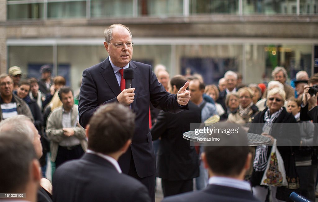 Social Democrats (SPD) chancellor candidate <a gi-track='captionPersonalityLinkClicked' href=/galleries/search?phrase=Peer+Steinbrueck&family=editorial&specificpeople=209110 ng-click='$event.stopPropagation()'>Peer Steinbrueck</a> delivers a speech during a campaign appearance on September 20, 2013 in Wiesbaden, Germany. Germany is facing federal elections scheduled for September 22 and a wide spectrum of political parties is vying for votes.