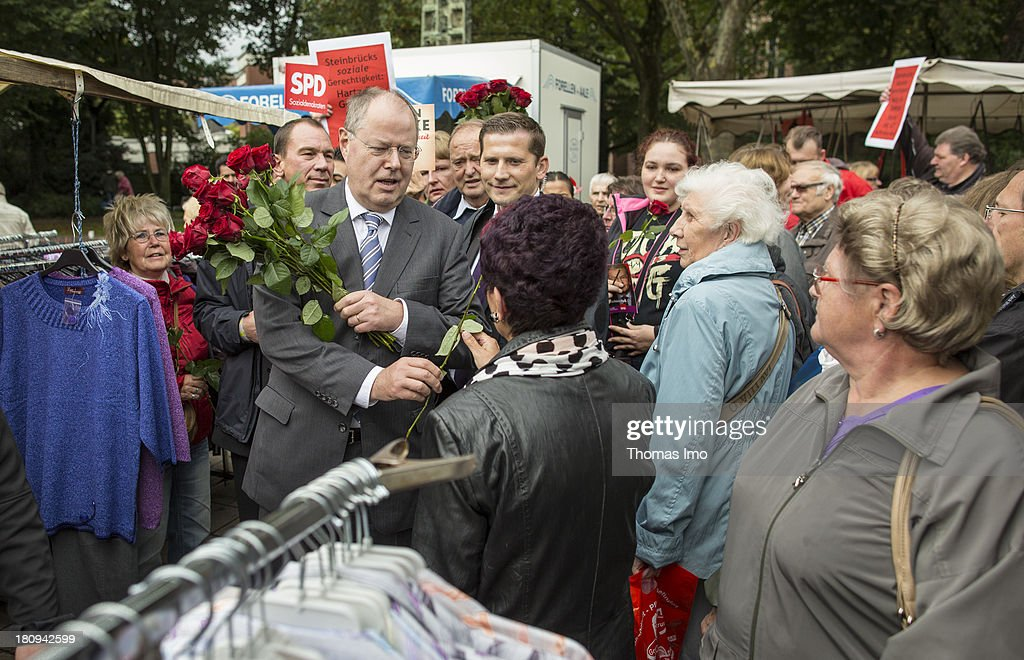 Social Democrats (SPD) chancellor candidate Peer Steinbrueck during a road election campaign at a weekly market on September 18, 2013 in Gelsenkirchen-Horst, Germany. Germany is facing federal elections scheduled for September 22 and a wide spectrum of political parties is vying for votes.