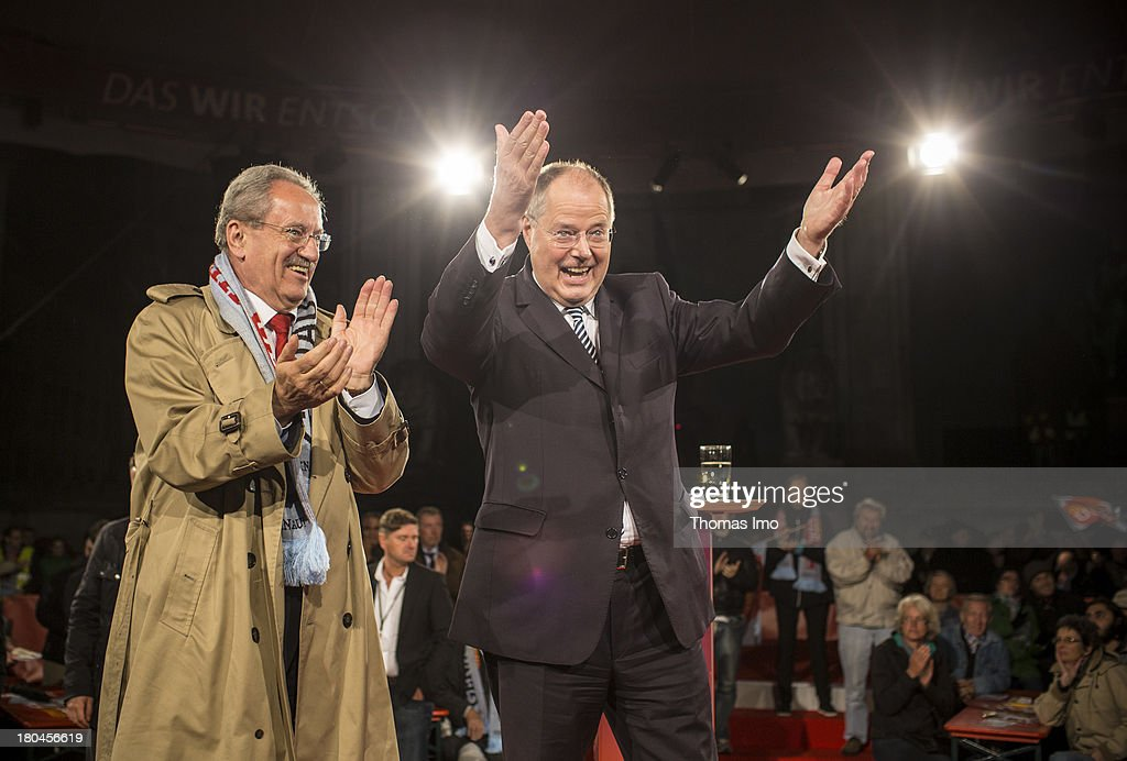Social Democrats (SPD) chancellor candidate <a gi-track='captionPersonalityLinkClicked' href=/galleries/search?phrase=Peer+Steinbrueck&family=editorial&specificpeople=209110 ng-click='$event.stopPropagation()'>Peer Steinbrueck</a> (R) next to <a gi-track='captionPersonalityLinkClicked' href=/galleries/search?phrase=Christian+Ude&family=editorial&specificpeople=729442 ng-click='$event.stopPropagation()'>Christian Ude</a> (L), top candidate of the SPD for the Bavarian Parliament Election, during a campaign event on September 12, 2013 in Munich, Germany. Germany is facing federal elections scheduled for September 22 and a wide spectrum of political parties is vying for votes.