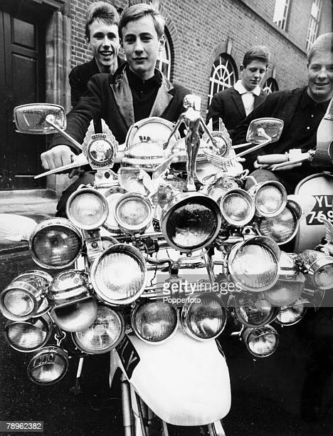 8th May 1964 Great Britain Young Mod John Rogers with a scooter which boasts 27 lamps plus horns mirrors badges and chrome mascots By 1964 many of...