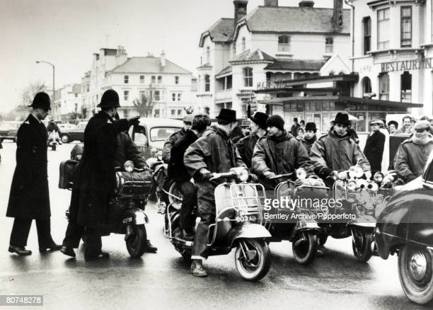 1964 Mods and Rockers A group of 'Mods' arrive on scooters in Clacton Essex to be closely watched by police Seaside towns in England were the scene...