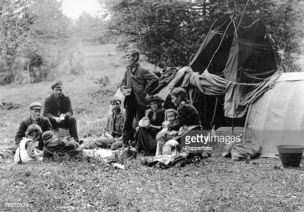 circa 1890's New Forest Hampshire England A gypsy family outside a ' bender' tent in the New Forest