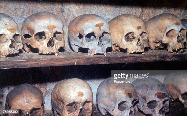 circa 1960 England Northamptonshire Rothwell The bone crypt at Rothwell Church showing skulls in line