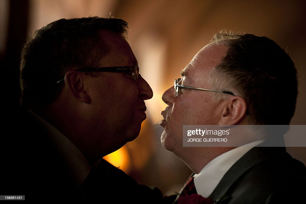 Social inclusion minister in the state government of South Australia Ian Hunter (R) and Leith Semmens (L) kiss during wedding in Jun, near Granada on December 19, 2012. Hunter and his partner have come from Adelaide to tie the knot in Jun.