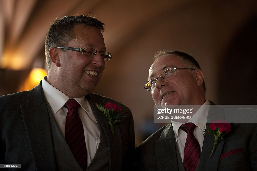 Social inclusion minister in the state government of South Australia Ian Hunter (R) looks at Leith Semmens (L) during their wedding in Jun, near Granada on December 19, 2012. Hunter and his partner have come from Adelaide to tie the knot in Jun.