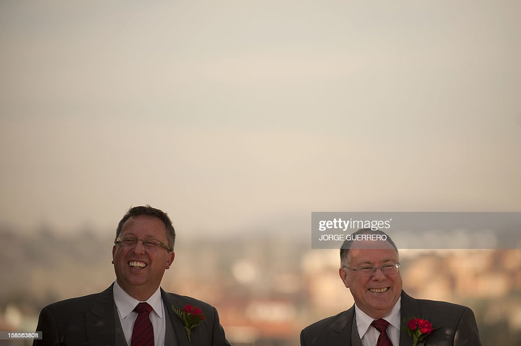 Social inclusion minister in the state government of South Australia Ian Hunter (R) and Leith Semmens react as they pose during their wedding in Jun, near Granada on December 19, 2012. Hunter and his partner have come from Adelaide to tie the knot in Jun.