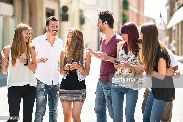 social media addiction people using the smartphone on the street