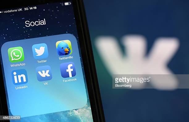 Social media apps including WhatsApp Twitter LinkedIn VKontakte and Facebook sit on an Apple Inc iPhone 5 smartphone in this arranged photograph in...