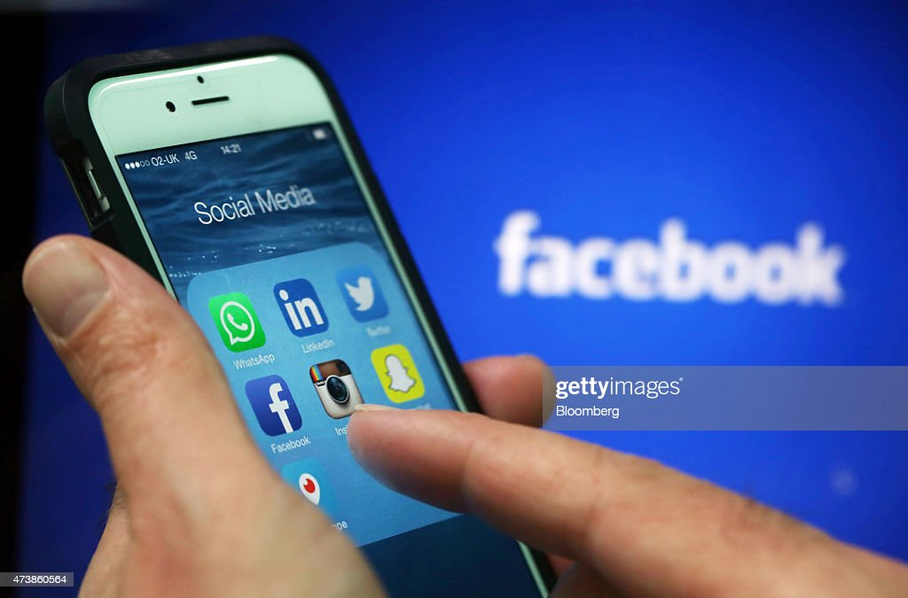 Social media apps including WhattsApp LinkedIn Twitter FaceBook Instagram SnapChat and Periscope are displayed in a social media folder on the screen...