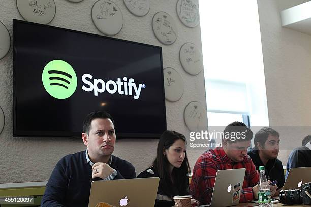 Social media bloggers listen as Spotify CEO Daniel Ek announces that the online streaming music service will expand to 20 new markets around the...