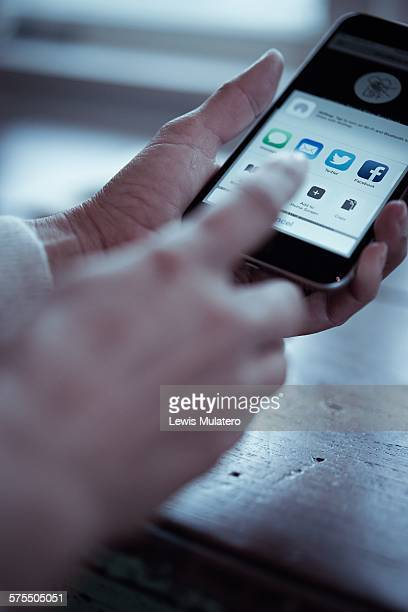 Social media Close up of a woman's hands holding a mobile phone ready to upload and share images to a social network site Space for copy