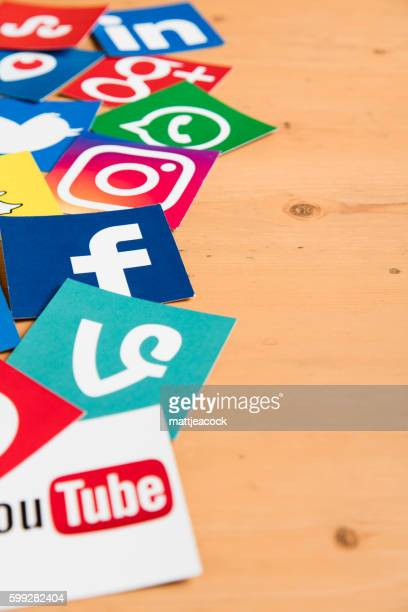 Social media icons on a wooden background