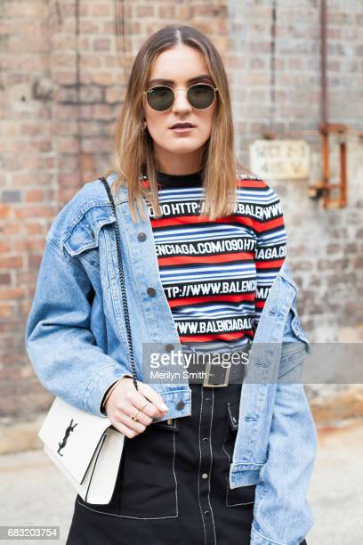 Social Media Influencer Holly Titheridge is wearing a vintage Levi jacket Balenciaga sweater Lover skirt YSL bag and Rayban sunglasses during...