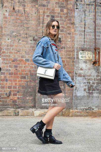Social Media Influencer Holly Titheridge is wearing a vintage Levi jacket Balenciaga sweater Lover skirt YSL bag Rayban sunglasses and Phillip Lim...