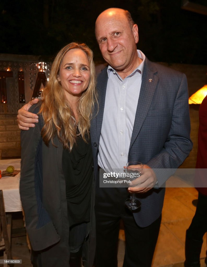 Social media investor Clare Munn and CEO of Giving Back Funds Marc Pollick attend the screening for 'The Square' at the home of Maria Bello on October 11, 2013 in Santa Monica, California.