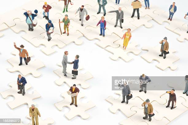 Social Media Little people on puzzle pieces
