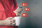 Social media. Social network concept with smart phone and coffee cup.
