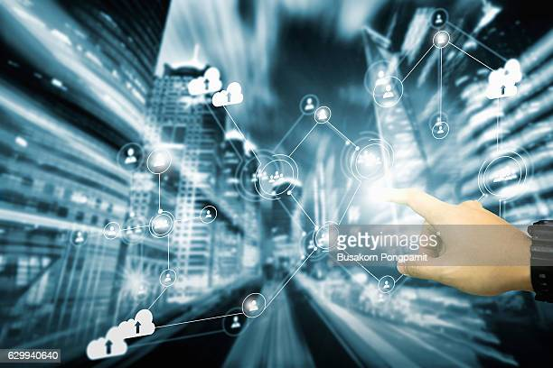 Social networking technology . Mixed media, businessman touching with finger network