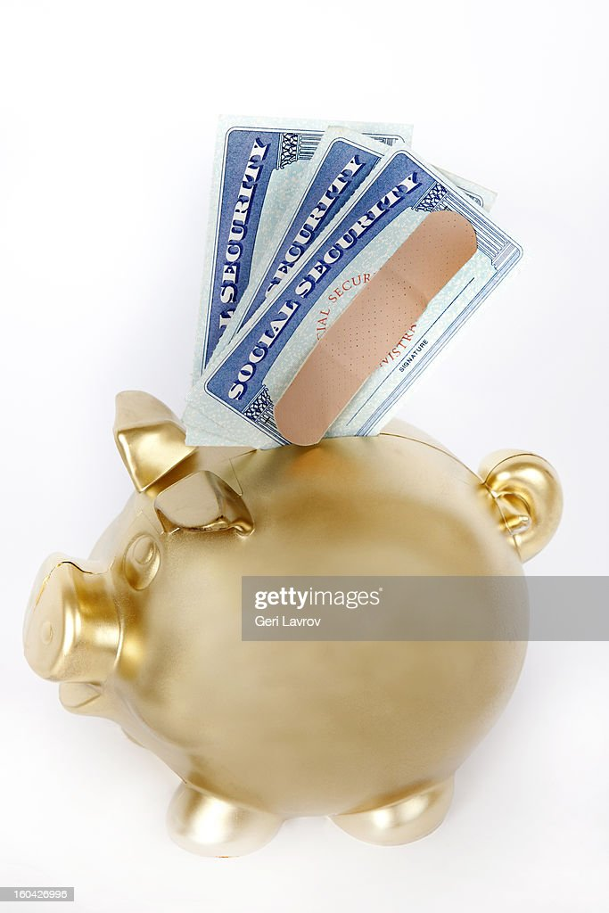 Social security cards and piggy bank : Stock Photo
