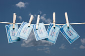 Social security cards on clothes line