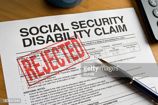 A Social Security Disability Claim Form Stamped Rejected Stock