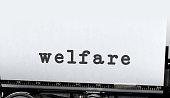 Welfare written on old typewriter. Copyspace
