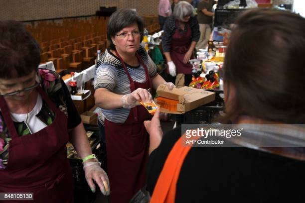 Social welfare recipients receive food and hygiene items at a counter of the 'Duesseldorfer Tafel' in a church in DuesseldorfGarath western Germany...