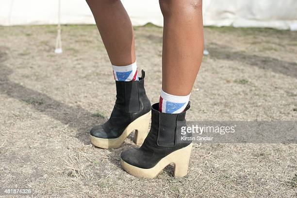 Social worker Danielle McKenzie wears All Saints shoes Topshop socks at Lovebox 2015 on July 18 2015 in London England