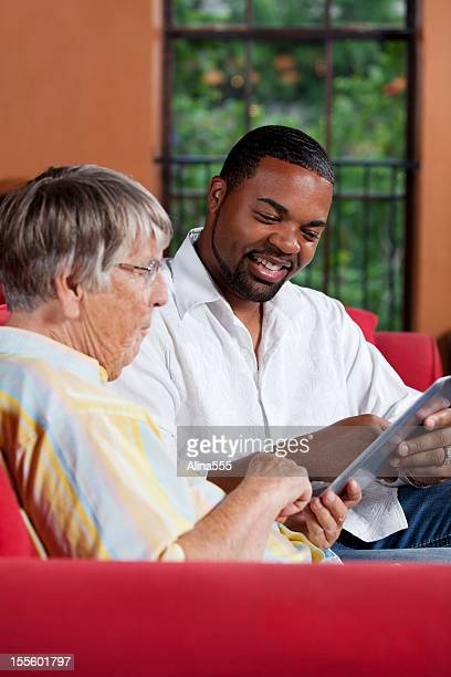 Social worker explaining something to a senior woman