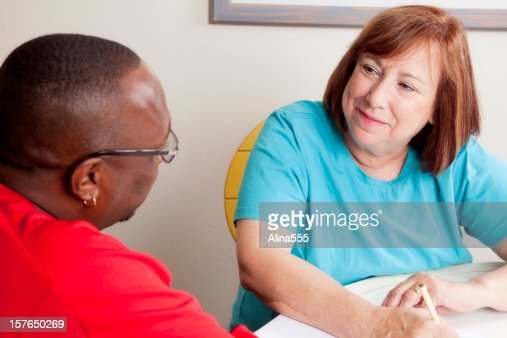 Social worker interviewing african-american man